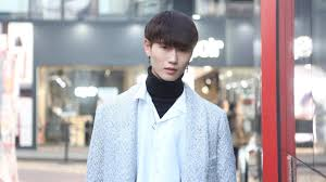 young man in seoul wearing make up