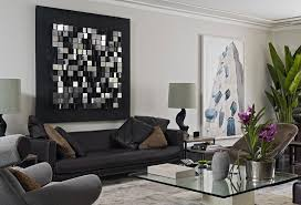 living room with large mirror wall art