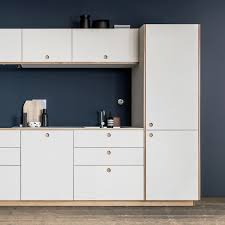 white cabinets with centered finger pulls in blue kithchen