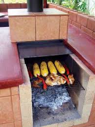 grilling corn en and peppers in the outdoor oven