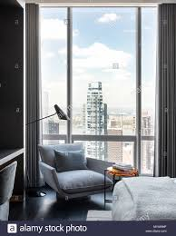 Armchair By Apartment Window In New York City Usa Stock Photo
