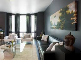 modern gray living room with bay windows and colorful art