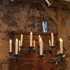 country french and english antique furniture and accessories lighting antique iron chandelier with two iron rings supporting the candlesticks