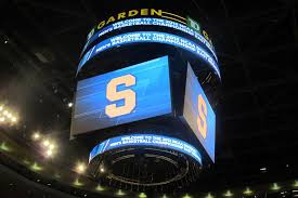the syracuse logo lights the jumbotron at the t d garden in boston as the team practices