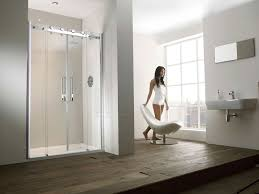 horrible modern shower room decor ideas with double glass shower door and brown wooden floor also stylish white chair also floating white vessel sink feat