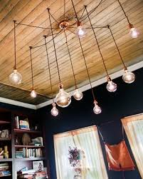 interesting ceilings with edison bulb chandelier and crown molding plus interior paint color