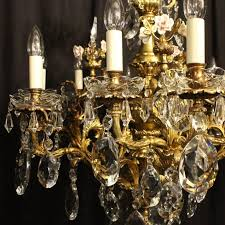 a french gilded cast bronze and crystal twelve light cherub antique chandelier the acanthus