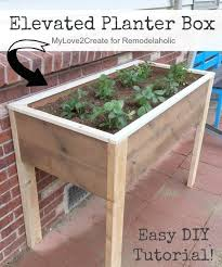 this diy elevated planter box is raised up off the ground so you can have garden planters t27