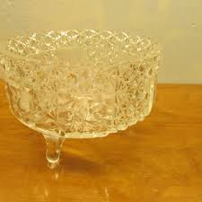 vintage three footed crystal bowl with glass ladle
