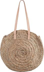 round basket in natural straw and pompons with leather handles sac pompons rio naturel beau comme un lundi