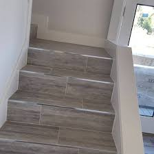 carpet tiles for stairs awesome look at those schluter edged stone tile stairs the devil is