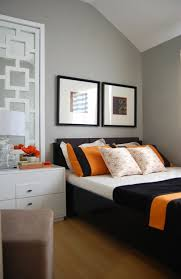 Orange & Gray room A bedroom painted with gray shades accentuated with  orange & black highlights.