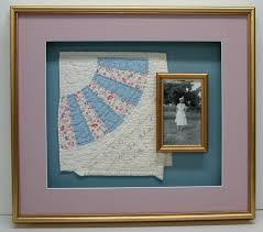 We specialize in shadowboxes for your 3D objects and collections. & Family heirloom quilt and photo. Adamdwight.com
