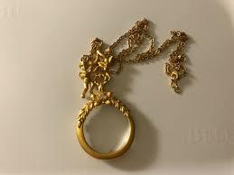 avon cherub magnifying glass pendant