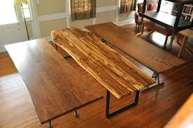 live edge cherry hickory and oak table tops in the le show room we typically have