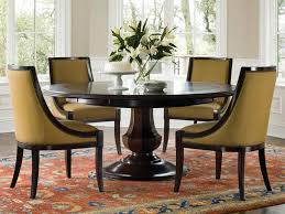 simple yet classy round dining table design wooden round dining table design with ornamental plants