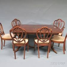 georgian style gany two pedestal dining table and a set of six shield