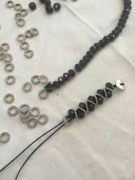 Metal Rain-AM $75. I <b>may</b> make this with paper beads today ...