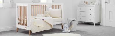 how to help baby sleep in a cot woolroom