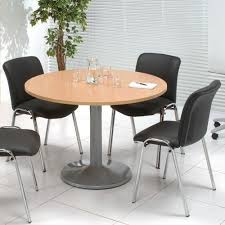 brown wooden round meeting room table