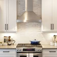 stainless steel vent hood. White Cabinets With Tile Marble Backsplash, Stainless Steel Hood, And Under-counter Lighting. Vent Hood I
