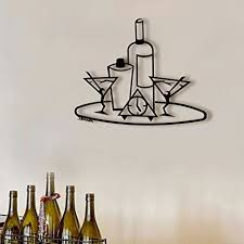 And, once you relax, you notice the charming ensemble of wall art that the owner has chosen. Amazon Com Martini Tray Bar Wall Art Metal Bar Art Black Metal Wall Art Metal Wall Decor Metal Wall Sculpture Home Kitchen