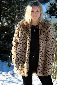 finally snow a little late for a white but still appreciated here s me miming a fashionable snow leopard in a faux fur coat by mango it s on