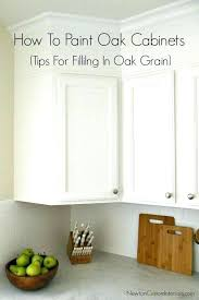 painting over stained cabinets in the kitchen without sanding paint or stain wood