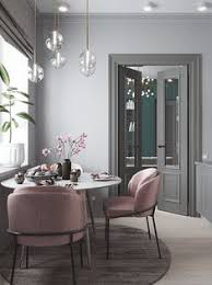 small dining room with a blush dusty pink arm chairs