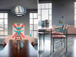 by using two diffe colors they added drama to the large room by using a darker paint color on the upper part of the wall and a softer color on the