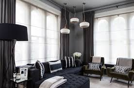 Black living room curtains Grey View In Gallery Dark Drapes Look As Elegant As Lighter Whiter Versions When Used Right from Decoist How To Use Dark Curtains To Shape Dramatic Cozy Interior