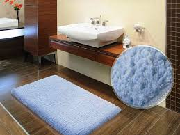 cozy laminate wood flooring with white bath rug for exciting bath mat design