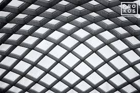 architectural detail photography. The Undulating Glass And Steel Canopy Of Kogod Courtyard, National Portrait Gallery, Washington DC Architectural Detail Photography
