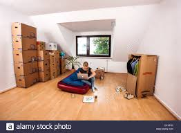 young woman in her new apartment still no furniture living out of moving boxes apartment furniture u40 furniture
