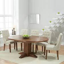 trina dark solid oak round extending dining table with 6 primly beige chairs 7212