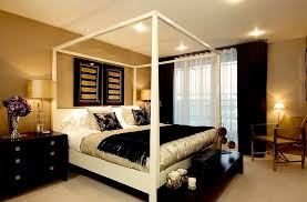 view in gallery wallpapered walls in gold and black decor and throws give the master bedroom a luxurious look bedroom ideas black
