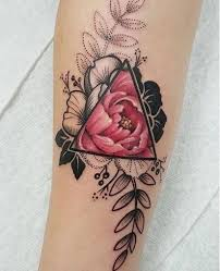 skillet rise tattoo. a very well detailed triangle glyph tattoo. you can see that the pink flower is fully colored within symbol as it slowly branches out skillet rise tattoo