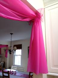 Use $1 plastic tablecloths to decorate doorways and windows for parties,  etc.. Wonderful