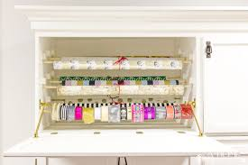 it s easy to repurpose an old armoire into a beautiful and organized gift wrapping station for