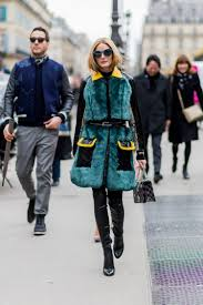 olivia palermo is wearing a fur coat and black leather pants and dior bag outside dior