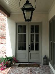 front door hanging light fixtures decor ceiling framed beam features gas lantern french style doors crooked
