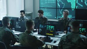 group of military it professionals on briefing in monitoring room on military base shot on base group creative office