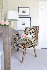 chic work space boasts a leopard print chair in tonic home bianca fabric lined with an