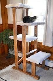 I really like this 4 Tier Hardwood Cat Tower with Scratcher from