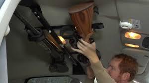 Center-Lok: Overhead Gun Rack for Trucks - YouTube