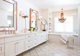 wood beaded chandelier over tub with arched shelves