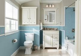 tub and shower surround with blue mosaic tile