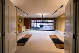garage inside with car. Inside Of A 2-car Garage That Was Designed For Catering Use When Entertaining. With Car