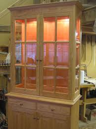 interior has 1 adjule upper cabinet 46 5 w x 15 5 d x 48 h beveled glass