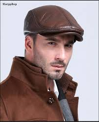 men s outdoor leather hat winter berets male warm ear protection cap 100 genuine leather dad hat whole leisure bone